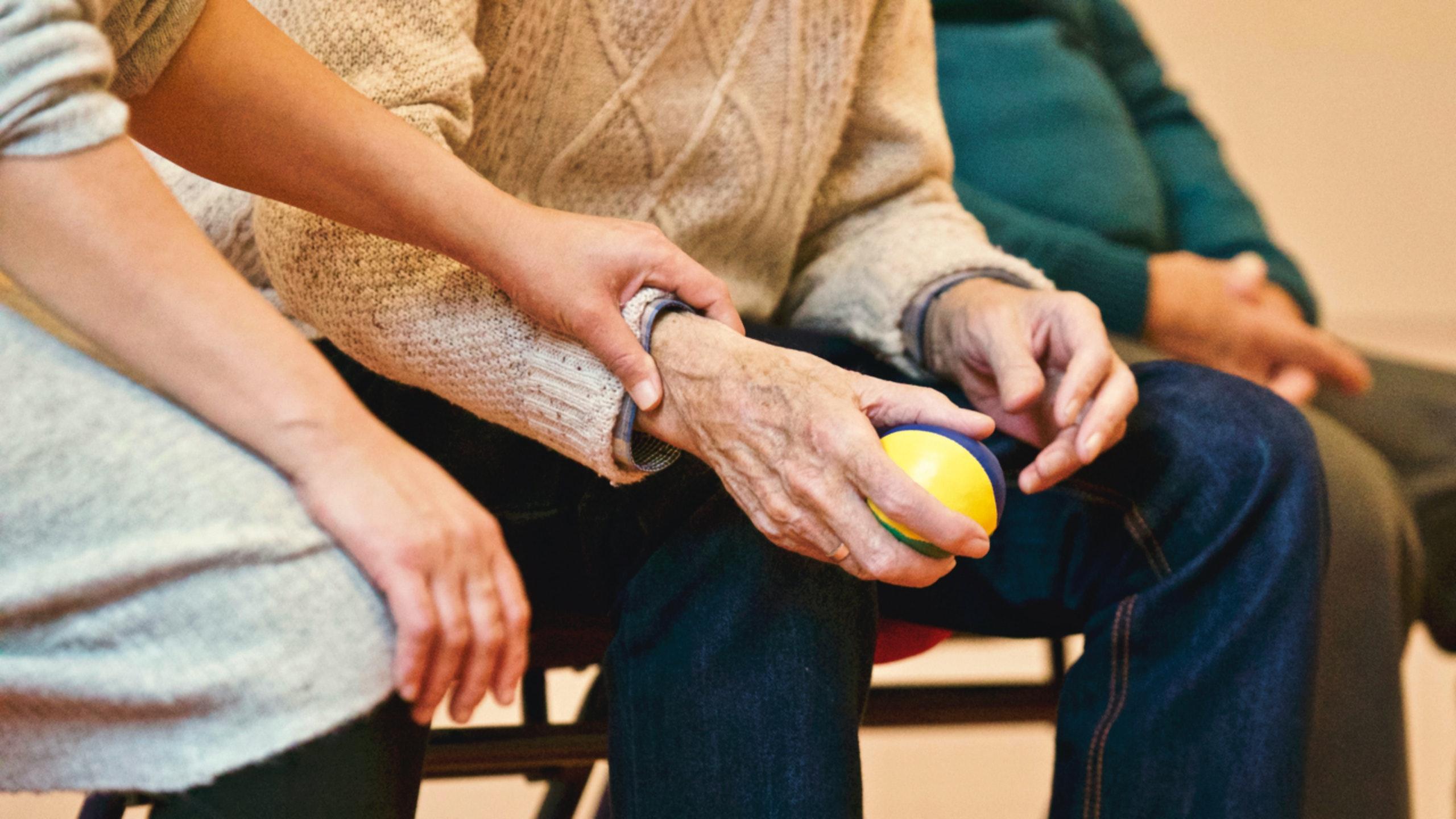 Nurse helping elderly cancer patient
